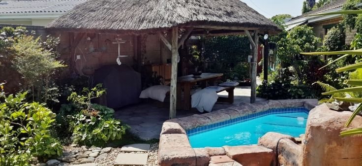 What a lovely setting! This splash pool and gazebo is just what you need for those long, hot summer days!