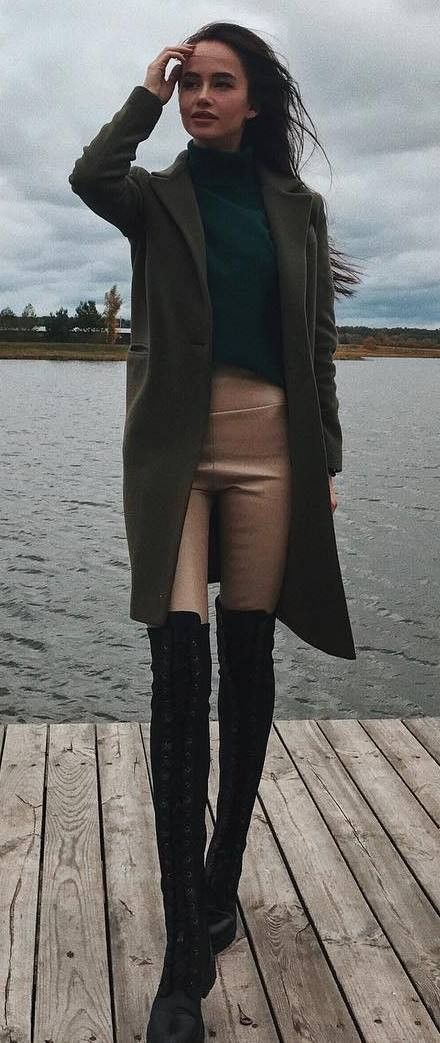 what to wear with a coat : black top   nude skinnies   lace up over knee boots