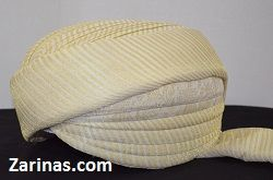 Cream Pre-Wrapped Turban.  Pakistani / Indian men's ready to wear pre-wrapped turbans (pagri) or Sherwani turbans. Our elegant turbans are perfect for special occasions, parties, or weddings and are sure to add a special touch to any traditional outfit. With charming colors and beautiful fabrics, these turbans will not disappoint. Color: Ivory and Cream.  Size: Medium  Styles available: Striped For more Afghan Turbans click below:  http://www.zarinas.com/turbans.shtml