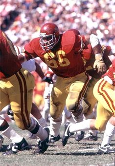 Bruce Matthews, #66 offensive guard of the University of Southern California Trojans football team runs up field to block at the Los Angeles Memorial Coliseum in Los Angeles, California.