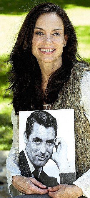 Jennifer Grant with a picture of her father, Cary Grant (She is also the daughter of Dyan Cannon).