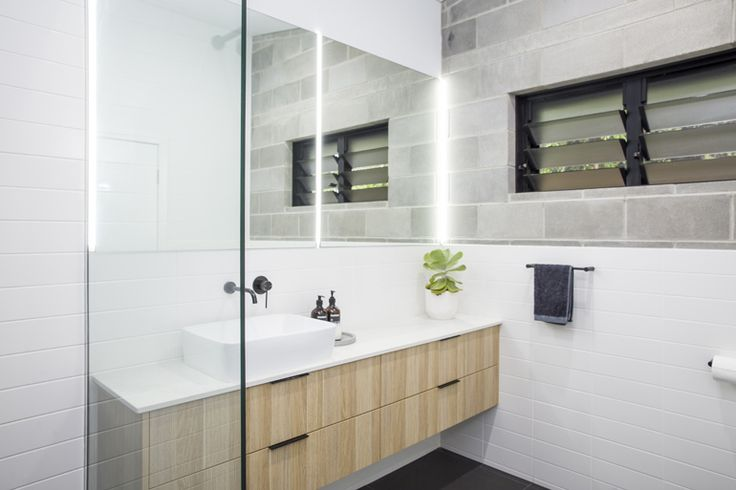 The Laneway House is located on a ten-metre-wide allotment, in an inner city suburb that is defined by small scale traditional Queenslander cottages a...