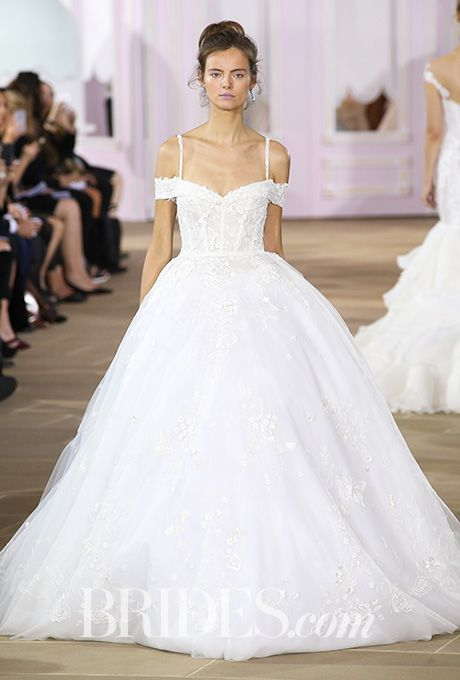 """Brides.com: . """"Belle"""" tulle ball gown with spaghetti straps and off-the-shoulder detail, Ines Di Santo"""