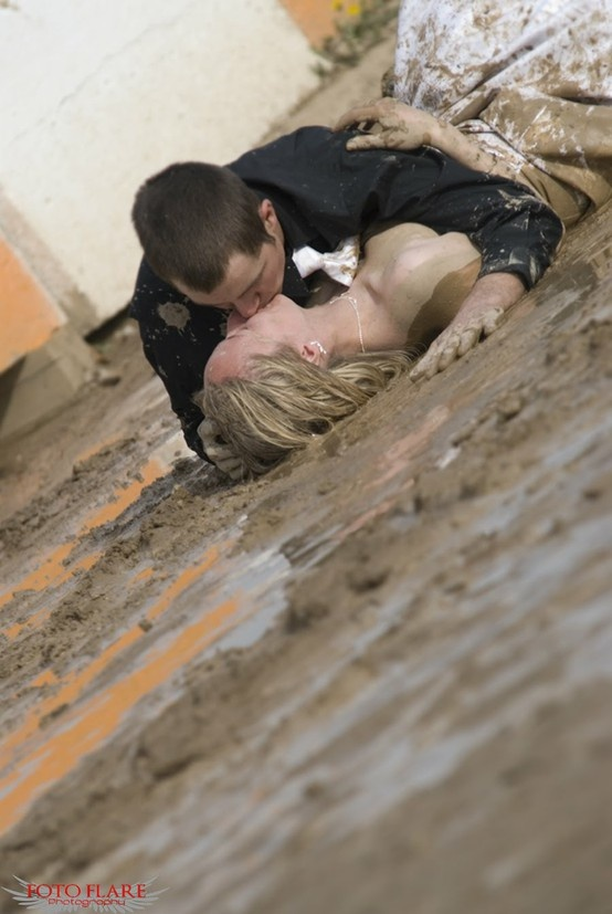 wedding mud wrestling...I wouldn't want to ruin my dress this way BUT I love the idea behind it :)