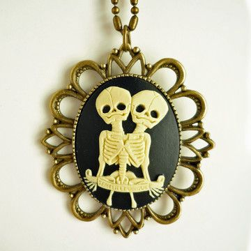 "The Twins Cameo Necklace now featured on Fab.We think this is a pretty awesome way to tell someone they complete you. A little bit of Goth, and a farthing of Victorian elegance, this retro Twins Cameo Necklace is lovingly handmade for all those who are fascinated by medical anomalies, or have a twin sister! The banner on the cameo reads ""Semper et Ubique,"" which means ""Always and Everywhere"" in Latin. Set in an antiqued brass base, this necklace puts a sultry twist on a classic cameo."