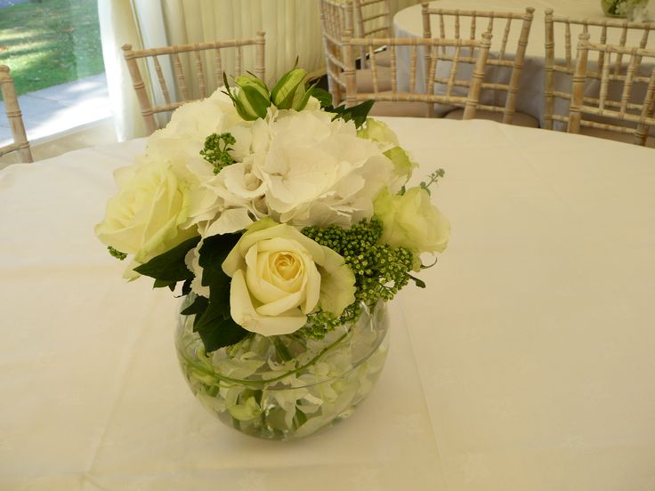Roses, Hydrangea and Lisianthus in a Goldfish bowl, with floating flowers and looped bear grass inside the bowl. Also perfect for corporate functions and events.