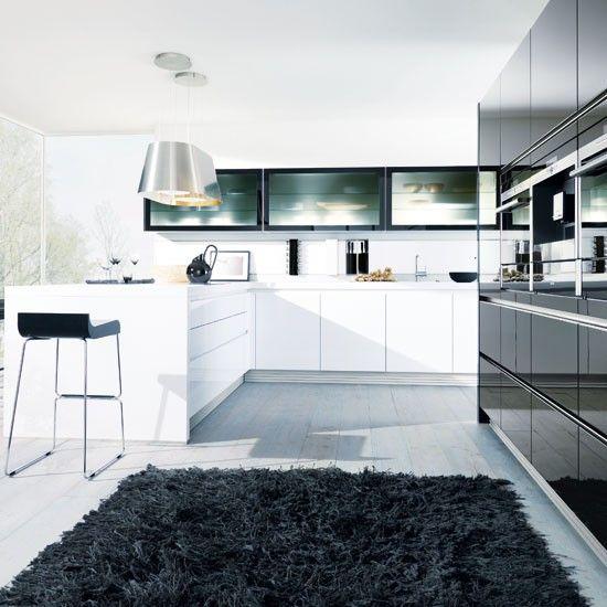 This sleek, modern kitchen is a hi-gloss handleless design by German company Sch…