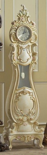 gorgeous ornate grandmother clock. gimme that in black lacquer.