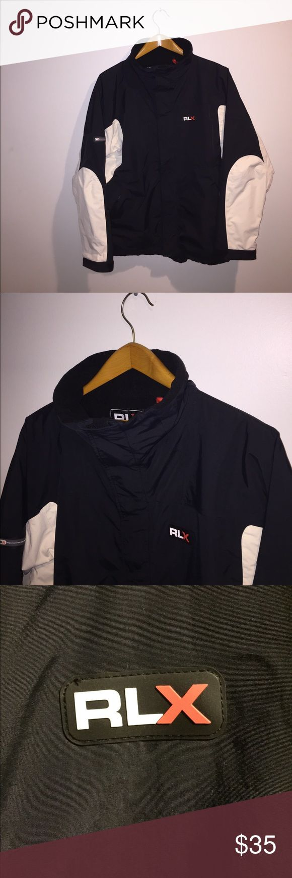 RLX Polo Sport Jacket A RLX Polo Sport Jacket in a navy blue, white and black color way. This is in a medium size and excellent condition. RLX Ralph Lauren Jackets & Coats Performance Jackets