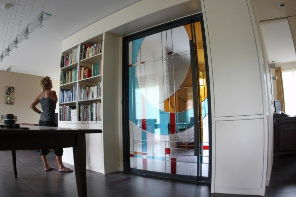 For oure client at Duizel ( Eindhoven) I design this art glass between the hall and livingroom.What a nice job I have!