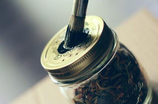 Paint jam jar lids with blackboard paint