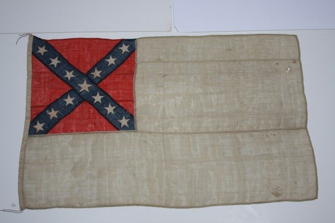 Second National Ensign of the CSS Alabama, June 1864.  This flag is the second and final ensign from the CSS Alabama's last battle, hoisted after the spinnaker gaff on which she wore her ensign was shot away. This smaller ensign, likely a boat flag, was eventually struck in a battle against the USS Kearsarge off the coast of France in 1864.