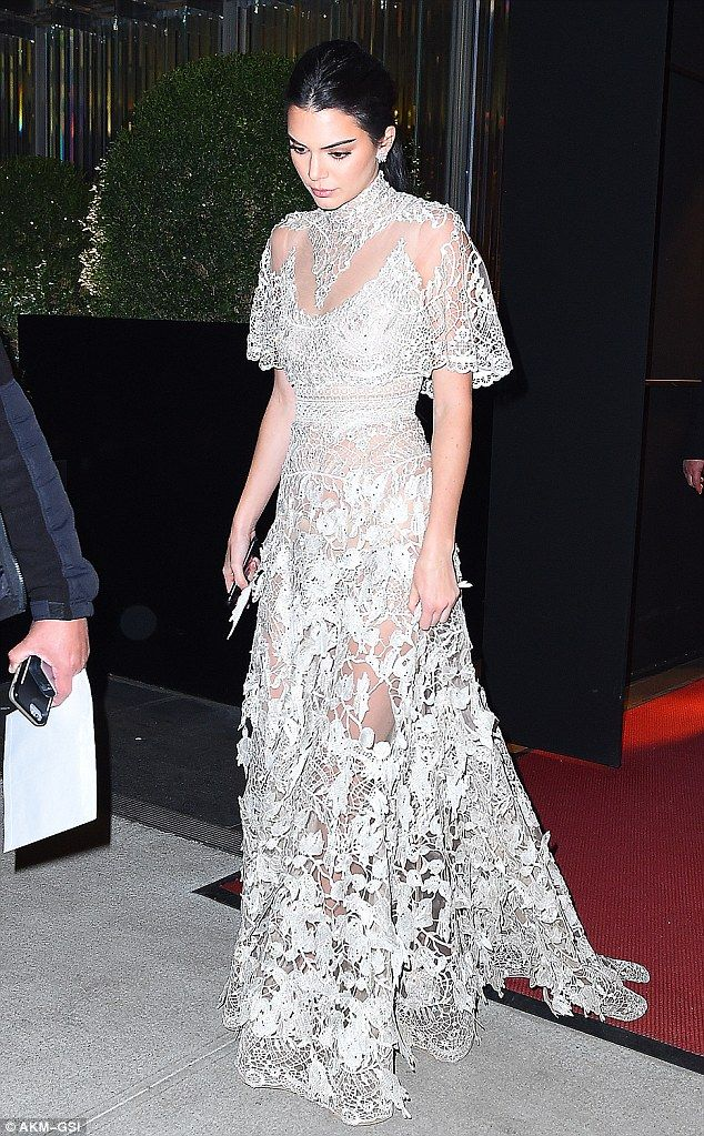 A little less see-through: Kendall's silver dress was a little more demure yet similarly s...