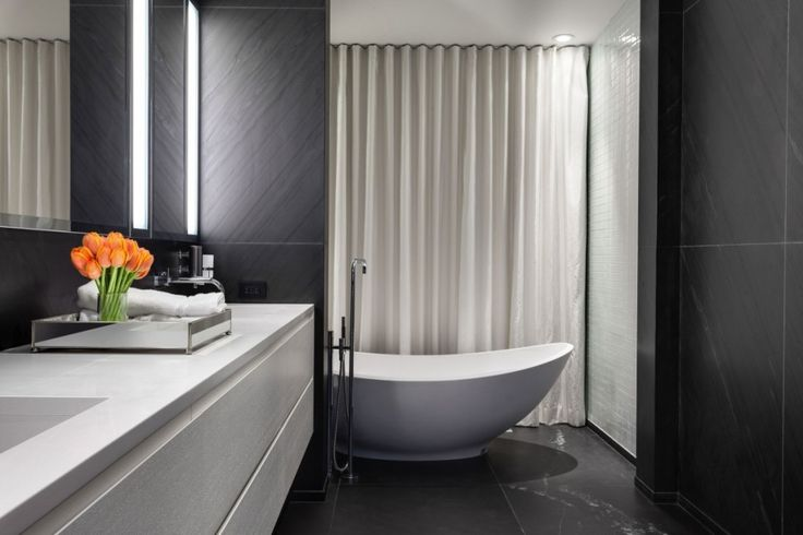 Interior:Modern Bathroom Design And Fancy Bathroom Design With Modern Bathtub Also Granite Tiles Bathroom Ideas With Elegant Vanity Bathroom With Bathroom Mirror And Flowers In Montreal Canada For Modern Bathroom Ideas Inspire Modern Mansion Style with Adorable Black Polka Dots Staircase in Canada