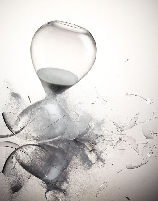 Hourglass shattering white background 251878