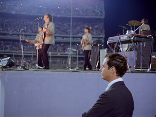 Brian Epstein watches the Beatles perform at Shea Stadium, New York, 15 August 1965