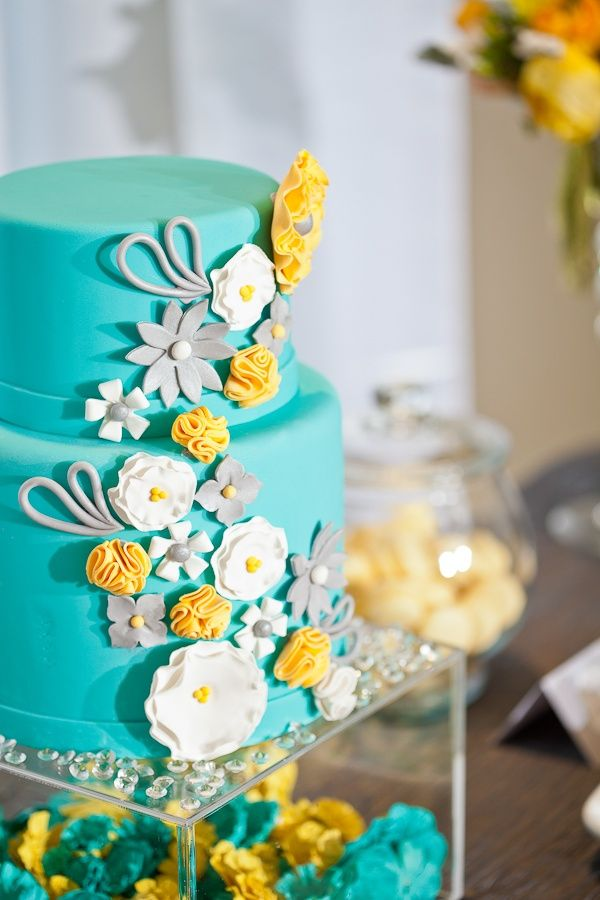 Aqua or light turquoise is an all time summer color, it adds a breezy touch as well as reminds us of beautiful beaches and pools. Yellow on the other hand gives a very fresh touch to the wedding and adds a lot of brightness. Here are some of our favorite ideas: Bright Wedding Cake.  Fun Wedding Invitations.