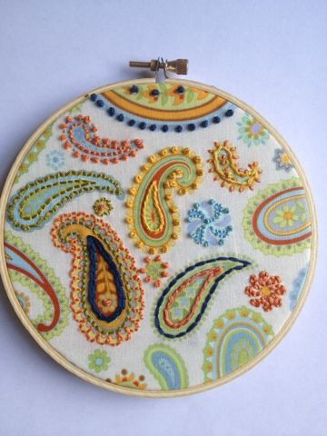 How cool is this? Hand embroidered on a printed fabric! I want to do this as a border on towels or something.!?! So cool!