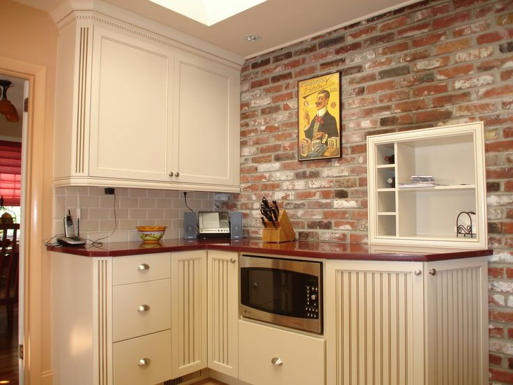 Kitchen Design Ideas with a Faux Brick Wall: Built In Eclectic Kitchen With Faux Brick Wall And Tile Backsplash Also Wine Storage Plus Recessed Lighting And Cream Kitchen Cabinets
