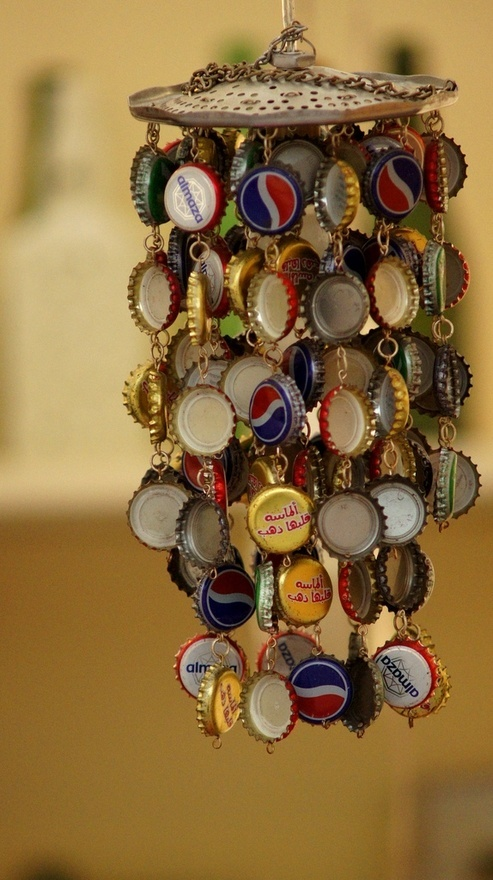 I collect Champagne caps that are on the top of the corks.  This is a great way to use them and it's on my list of projects to make my version of this bottle cap windchime.
