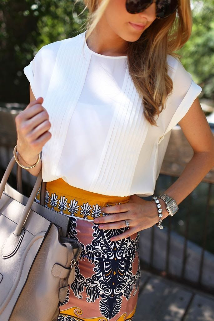 like the look of a white blouse and patterned skirt. nice accessories, too.