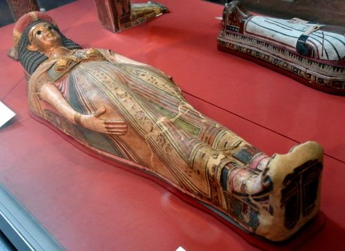 The practice of mummifying the dead began in ancient Egypt c. 3500 BCE. The English word mummy comes from the Latin mumia which is derived from the Persian mum meaning 'wax' and refers to an embalmed corpse which was wax-like. The idea of mummifying the dead may have been suggested by how well corpses were preserved in the arid sands of the country.
