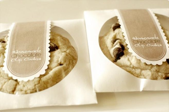 Love to bake? Then why not make a big batch of yummy homemade cookies wrapped in personalized bags for your guests? They'll appreciate the effort you put into their thank-you gifts.     Image via  Intimate Weddings.