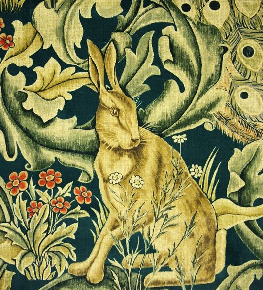 Forest Velvet A tapestry inspired fabric depicting a forest scene with peacocks, hares and foxes set amongst scrolling acanthus leaves. Digitally printed on azure with gold and natural shades of green, printed on velvet.