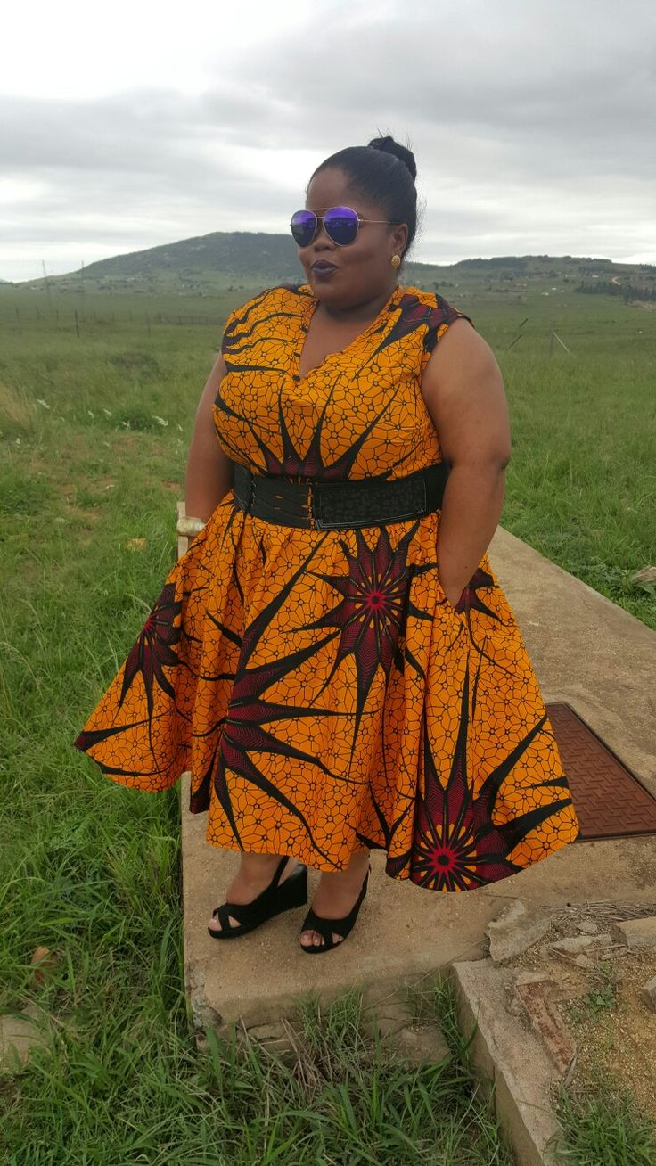 Home sweet home Swaziland wearing bold printed dress from bow africa... styled by Molebo