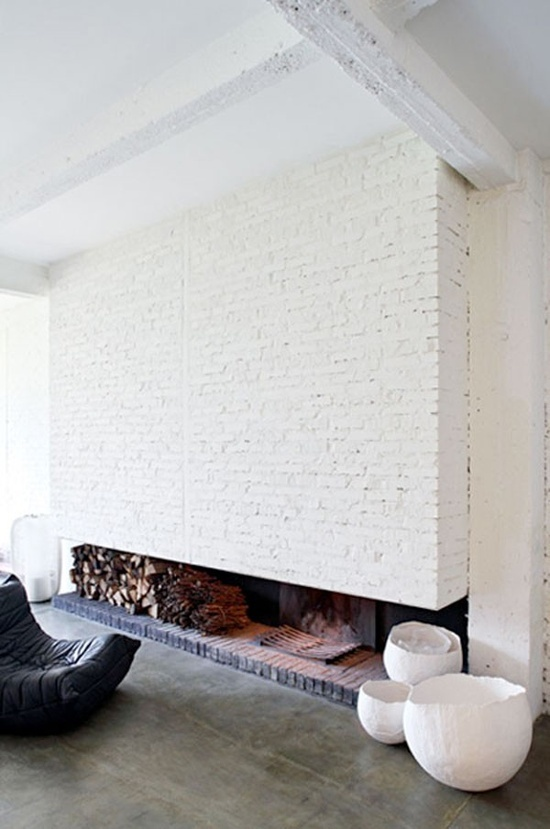 Beams and brick painted white, combined with polished concrete floor, make this living room an icon of clean and airy Scandinavian-inspired style.