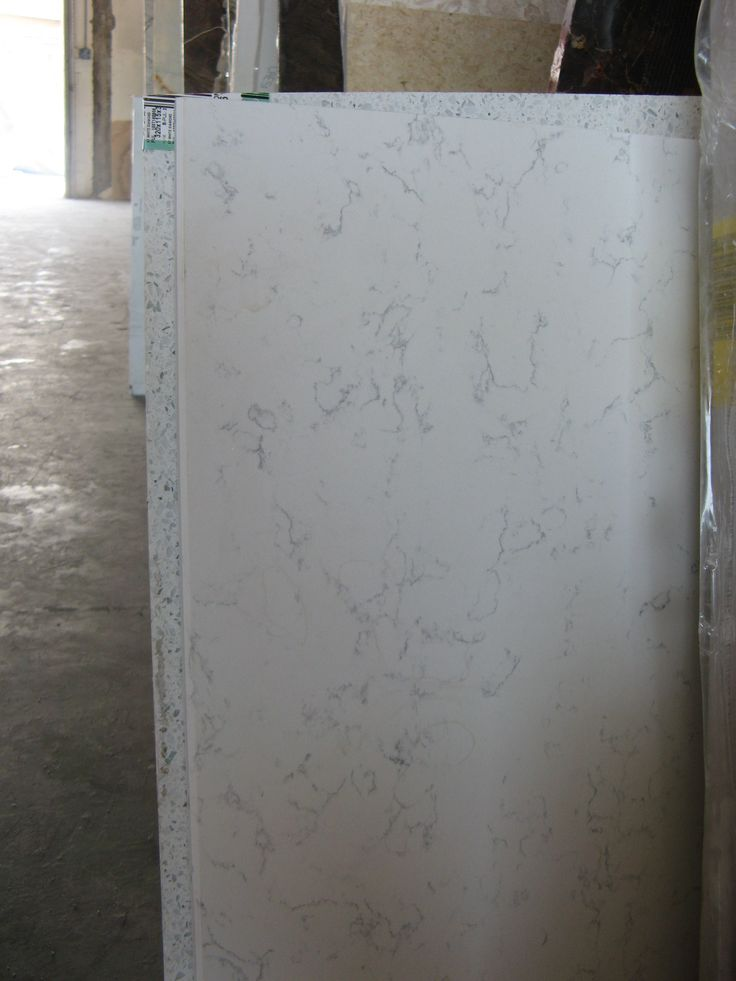 Countertops for kitchen  Zodiac Course Carrara  One option  Final decision not made  but looking for a Carrara Marble look quartz  Look of marble  but maintenance of quartz