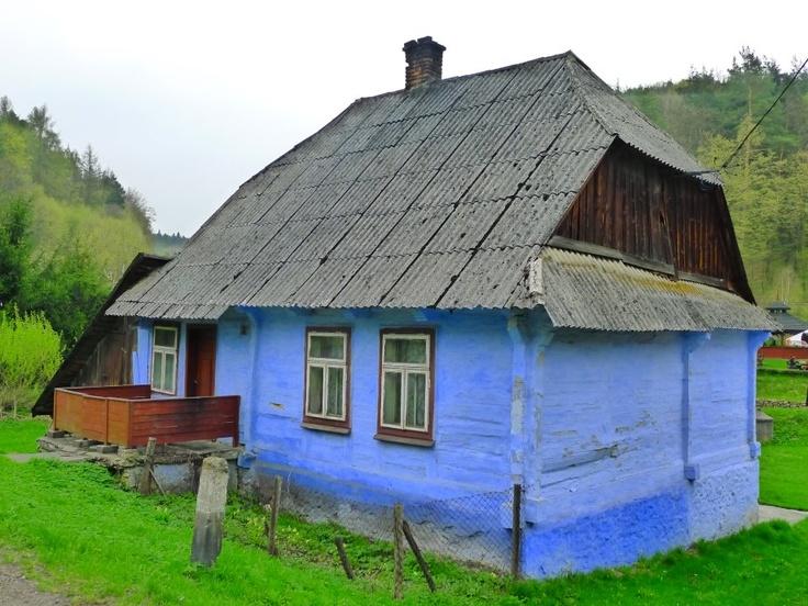 olg Polish log house, Ojców, Malopolska in traditional ultramarine limewash