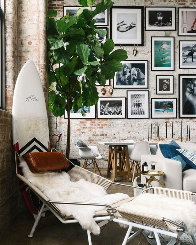 Brooklyn lofts are known for upping the cool factor—like the space above. But what makes this loft SO cool? Is it…  a. the surfboard 🏄  b. that gallery wall, though  c. brick walls, baby  d. three words: flag halyard chair  photo: @juliarobbs for @homepolish