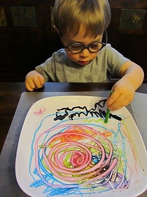 Warm a plate and then draw on with crayons.  To clean plate - warm again in microwave and wipe