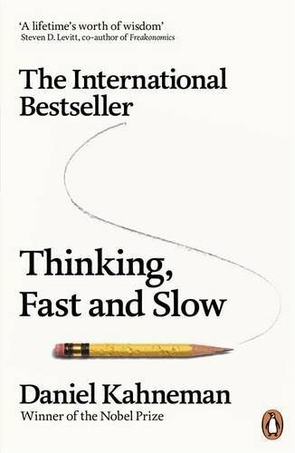 Thinking, Fast and Slow by Daniel Kahneman http://www.amazon.co.uk/dp/0141033576/ref=cm_sw_r_pi_dp_Raz-wb0QH4BWS