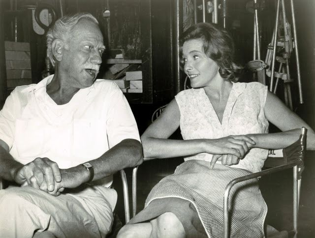 HUD (1963) - Melvyn Douglas chats with Patricia Neal on the set between scenes - Directed by Martin Ritt - Paramount - Publicity Still.