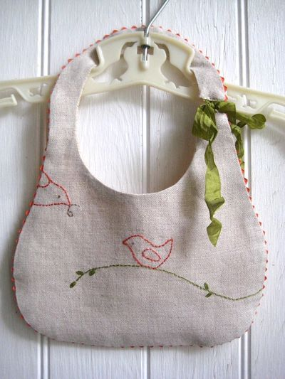bib project by Charlotte Lyons. Darling shower gift! Mama bird feeding baby bird embroidery - so sweet!