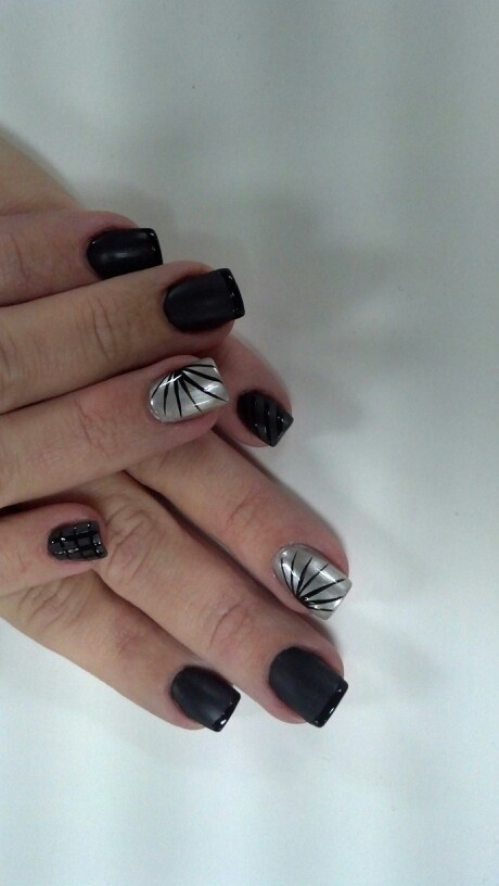 Flat black and silver nail art