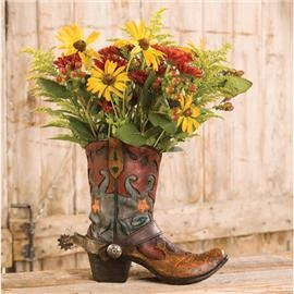 IN THE YARD:  Cowboy boot planter. This would be so perfect next to a wagon wheel in the corner of the yard.