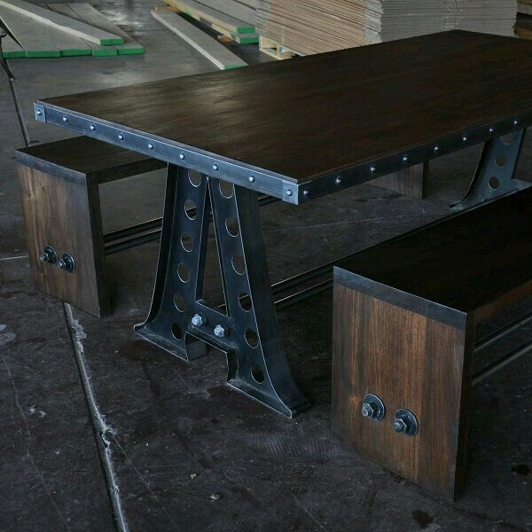 """Industrial salvage. 2"""" thick mahogany and recycled steel. Awesome table and benches."""