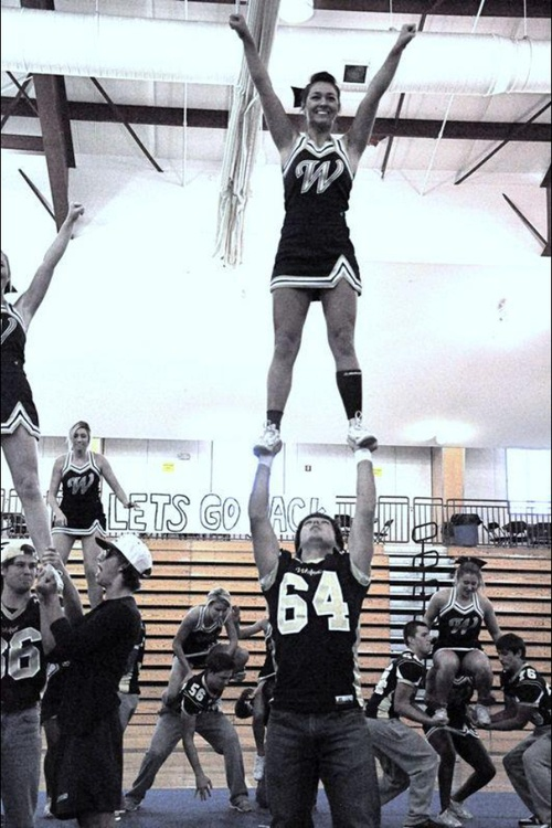 football players stunting with the cheerleaders! Wish our football players would do this!
