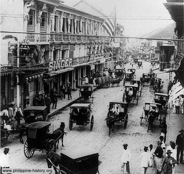 An old photograph of the bustling street of Escolta in Binondo, Manila. Taken on the 4th of July, 1898. Manila and portions of the Philippine islands was at that time occupied by the American forces after defeating the Spanish squadron in Manila Bay on May 1, 1898 during the Spanish-American War. This section consist of 30 vintage pictures of people and places in and around Manila, Philippines from the late 1800s to early 1900s.    - from www.philippine-history.org