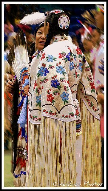"""Contemporary beaded dress: """"This photo was taken at the FSIN Pow Wow in Saskatoon Saskatchewan. These ladies in their Ladies Traditional Dance regalia found a some time to catch up and share a moment witheach other among the huge crowd of dancers."""" - CindyLou Photos, from This Beautiful World."""