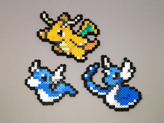 Handmade perler Pokemon creations! Feel free to request a shiny version of the Pokemon for no extra charge! Here are the sizes: Dratini - 2.5in H x 3in W Dragonair - 3.5in H x 3.5in W Dragonite - 3.5in H x 3.75in W When finished with a necklace, the chain is silver plated and closed with a lobster clasp.