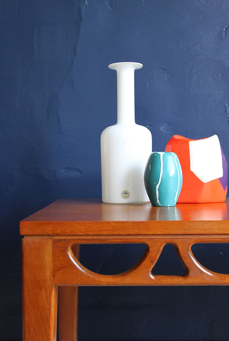 A pair of Avalon 1960s mid-century teak side tables, detail. Styled with Homlegaard Gulvase and Dinosaur Designs vases