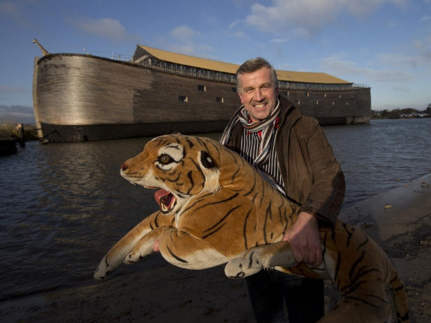 Johan Huibers poses with a stuffed tiger in front of his full-scale replica of Noah's Ark in Dordrecht, Netherlands. The Ark has opened its doors in the Netherlands after receiving permission to receive up to 3,000 visitors per day. Huibers - who had previously constructed a smaller version of the ark - said his $ 1.6 million replica has realized a 20-year dream to educate people about history and faith.