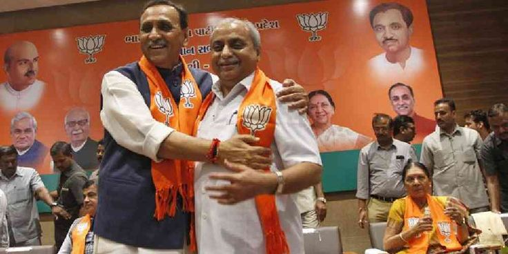 """Top News: """"INDIA: Narendra Modi Appoints Nitin Patel, Vijay Rupani"""" - http://politicoscope.com/wp-content/uploads/2016/08/Vijay-Rupani-left-Gujarat-president-of-Bharatiya-Janata-Party-BJP-is-congratulated-by-Nitin-Patel-as-he-is-selected-as-Chief-Minister-India-News-790x395.jpg - Nitin Patel told Indian news channels on Friday he was determined to start a dialogue with Dalit leaders and find ways to end the agitation.  on Politicoscope - http://politicoscope.com/2016/08/06/in"""