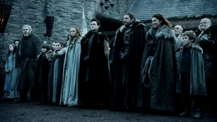 """This image is a screencap taken from a promotional video released by HBO. The image was taken by the administrators of Westeros.org and used with their permission. The image is copyrighted by HBO. The image shows House Stark and their retainers in """"Winter is Coming"""". From left to right: front Hodor, Bran Stark, Arya Stark, Sansa Stark, Robb Stark, Eddard Stark, Catelyn Stark, Rickon Stark; second row Rodrik Cassel and Luwin."""