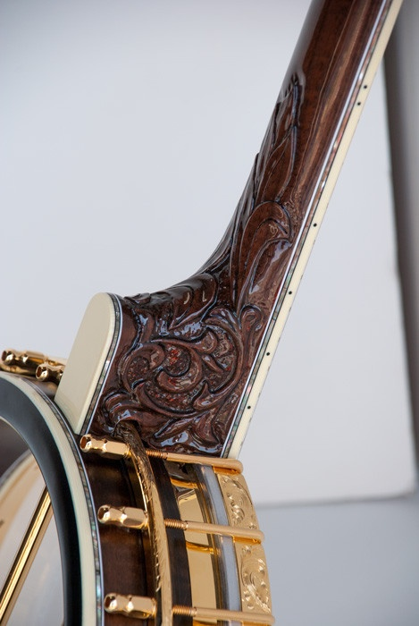 carved beautifully at the heel - the Deering Clawgrass banjo - played by Steve Martin!