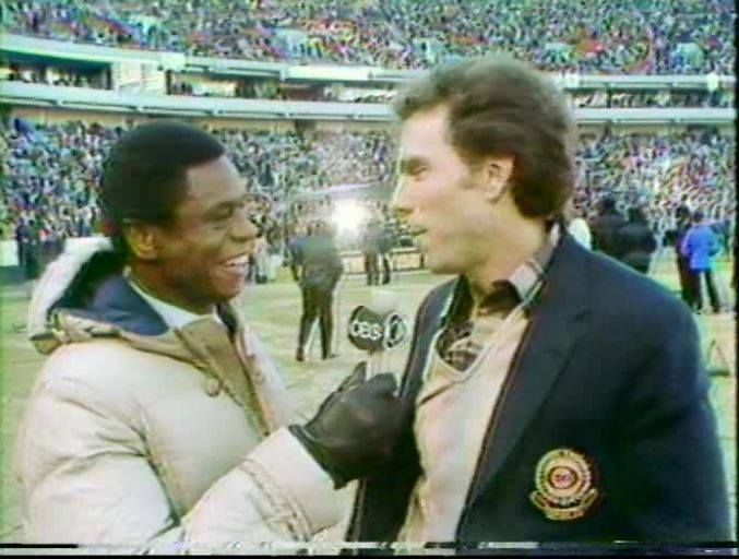 The NFL Today's Irv Cross interviews former Cowboys qb ROGER STAUBACH before the start of the NFC Divisional Playoff against the Atlanta Falcons on January 4, 1981.